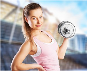 Image of woman lifting weight.
